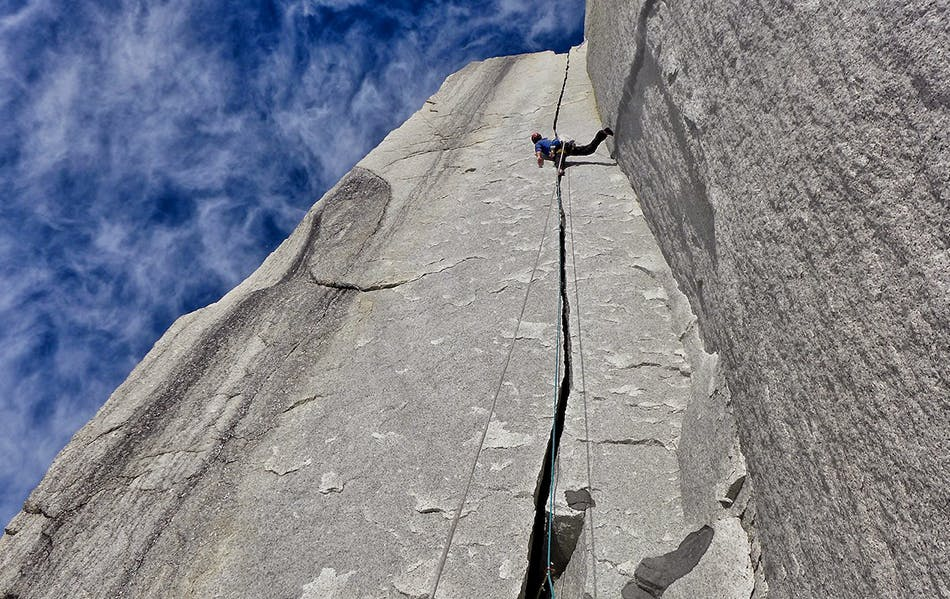 photo of climber in a crack on the wall