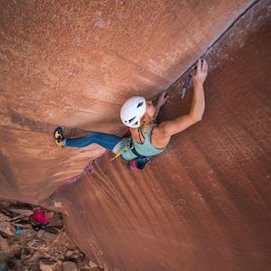 Hazel Findlay placing a piece on a climb