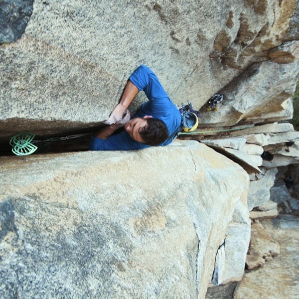 Chris climbing a wide granite crack