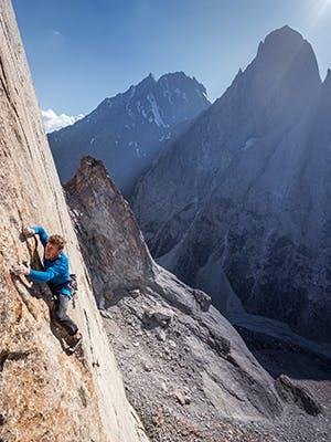 Nik Berry climbing a route