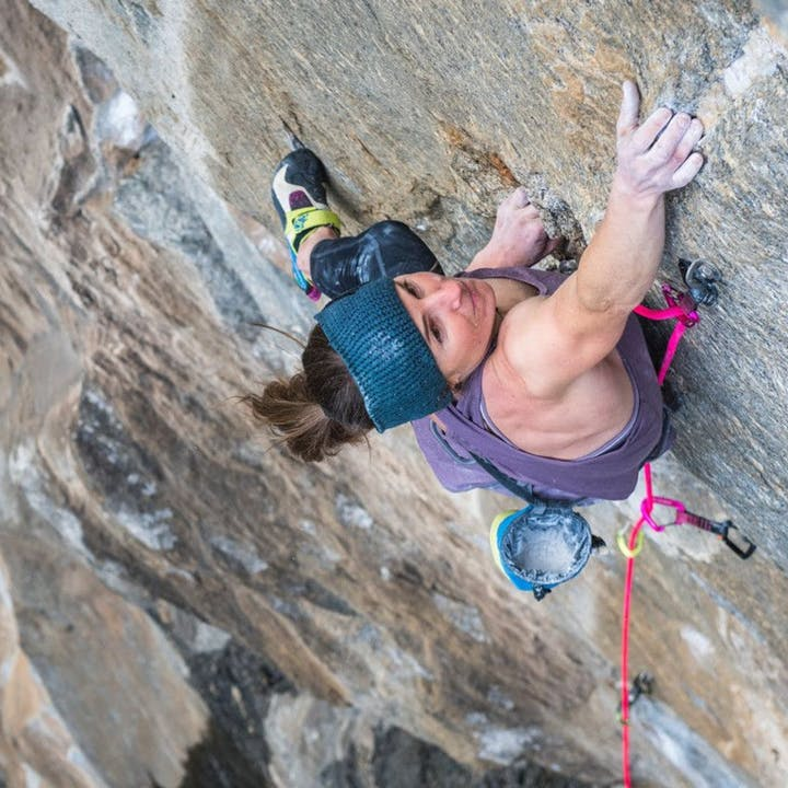 Photograph by Andy Earl of Babsi Zangerl rock climbing