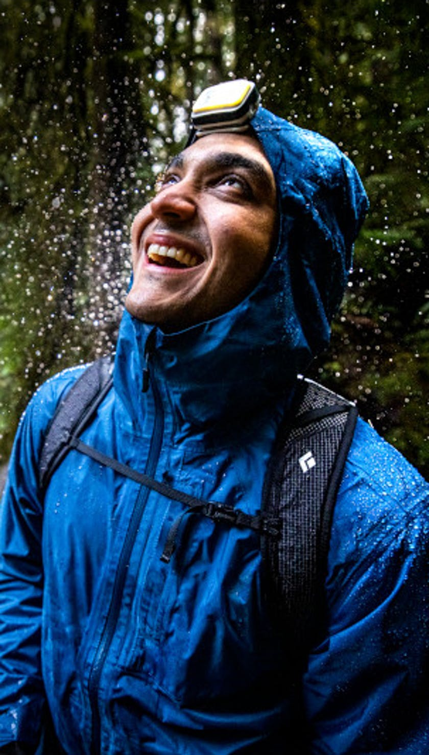 Man enjoying the rain in his Treeline shell
