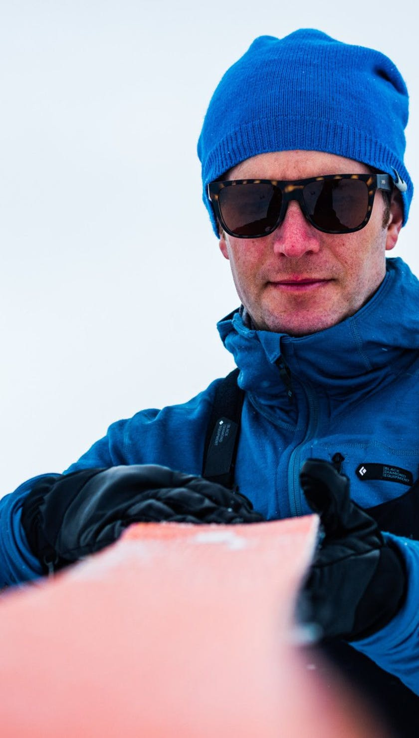 A person looking at their Acension skins on their ski