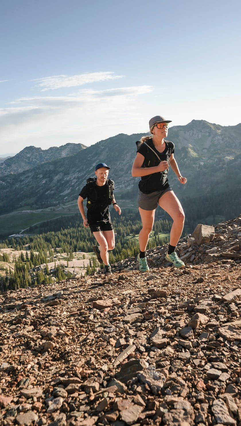 two runners going up a ridge