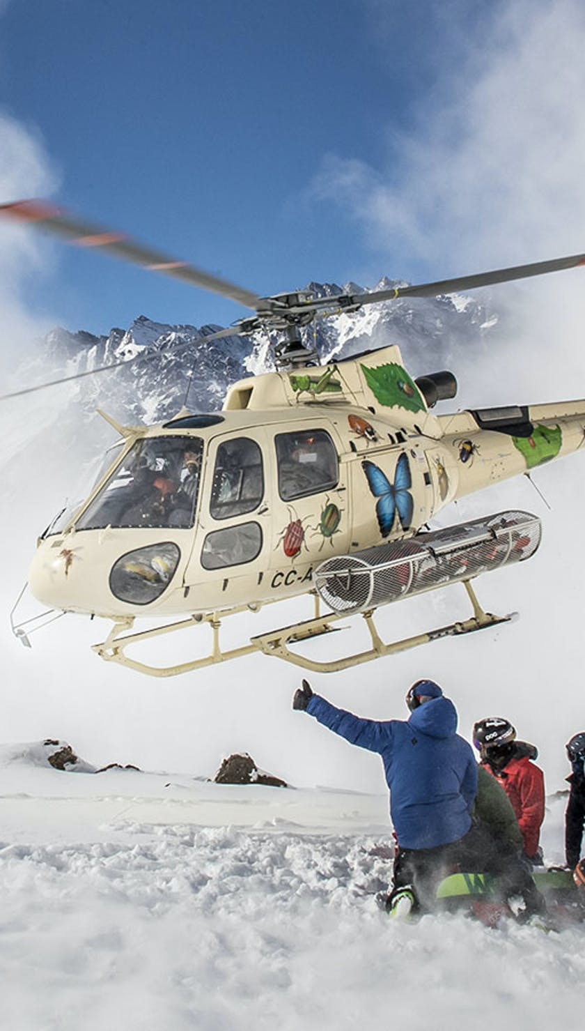 Skiers and helicopter