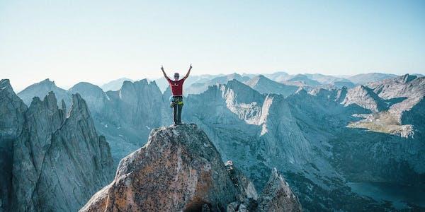 man on top of peak