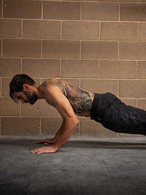 Profile photo of Sam Elias in mid pushup.