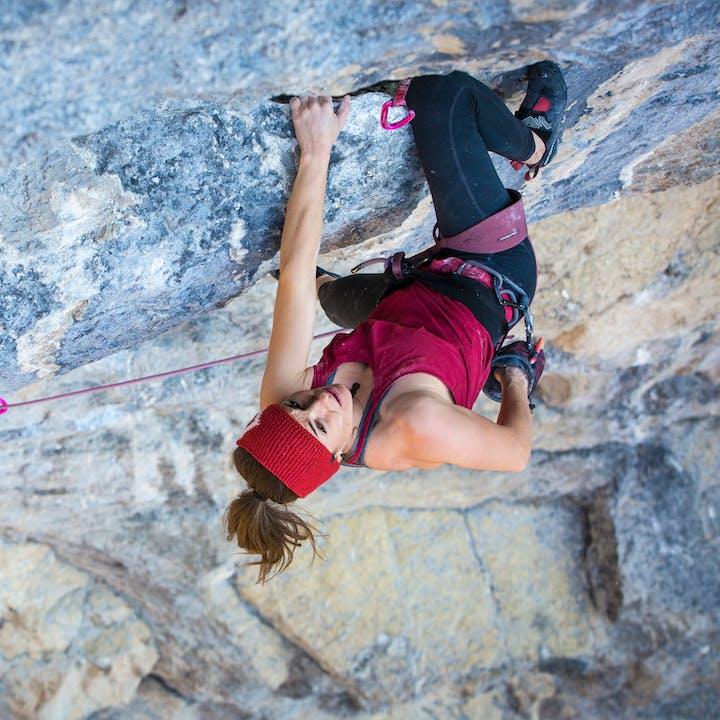 Black Diamond athlete Babsi Zangerl climbing outdoors using the Solution climbing harness