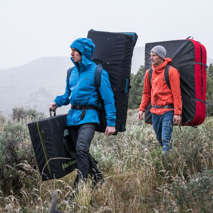 Photograph by Andy Earl of Carlo Traversi and Nalle Hukkataival walking with crash pads | Men's Rain jackets