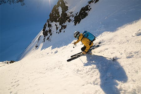 Photo of Antte Lauhamaa skiing in the mountains.