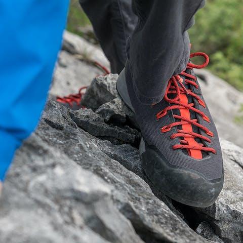 BD Approach shoes scrambling up a rock