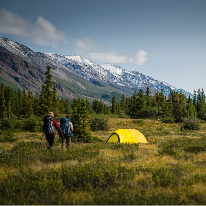 Hikers approaching their camp in the Canadian Yukon.