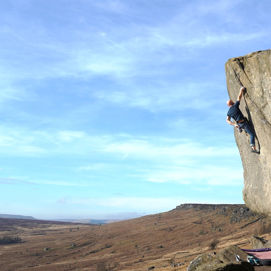 Chris bouldering on gritstone