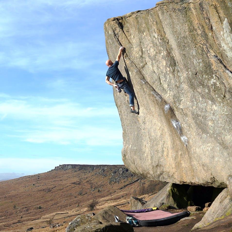 Chris bouldering on gritstone