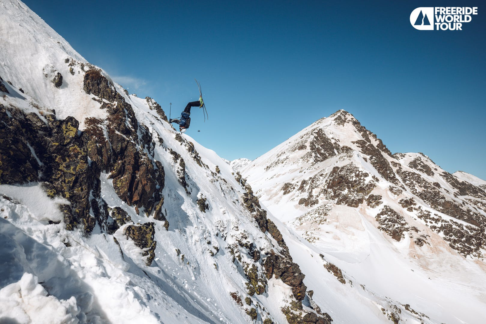 Isaac backflipping a cliff during the Ordino-Arcalis FWT stop