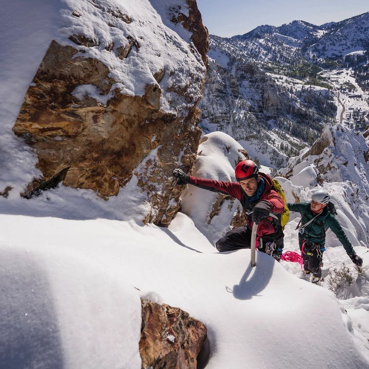 Photograph by Christian Adam of two men mountaineering on snowy mountain