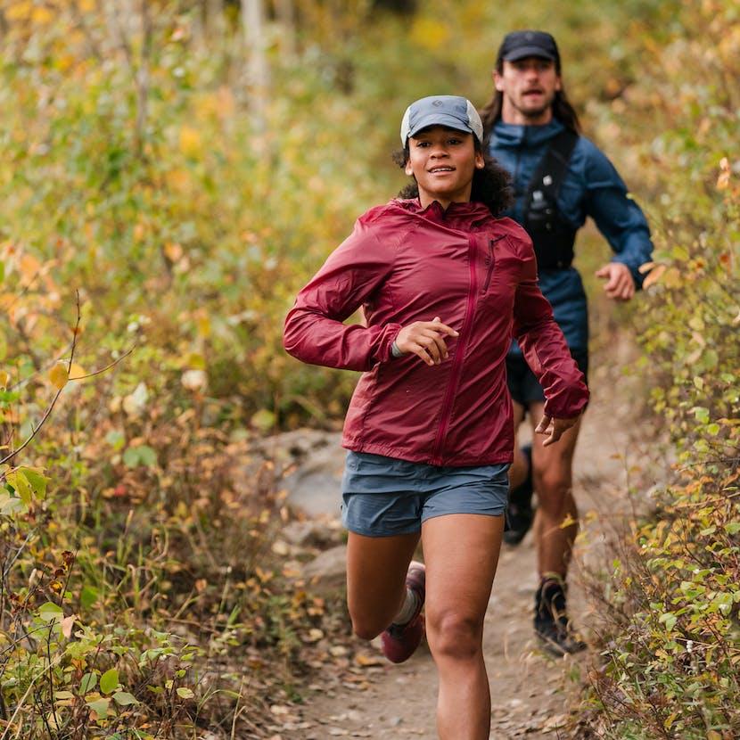 Two trail runners on downhill trek.