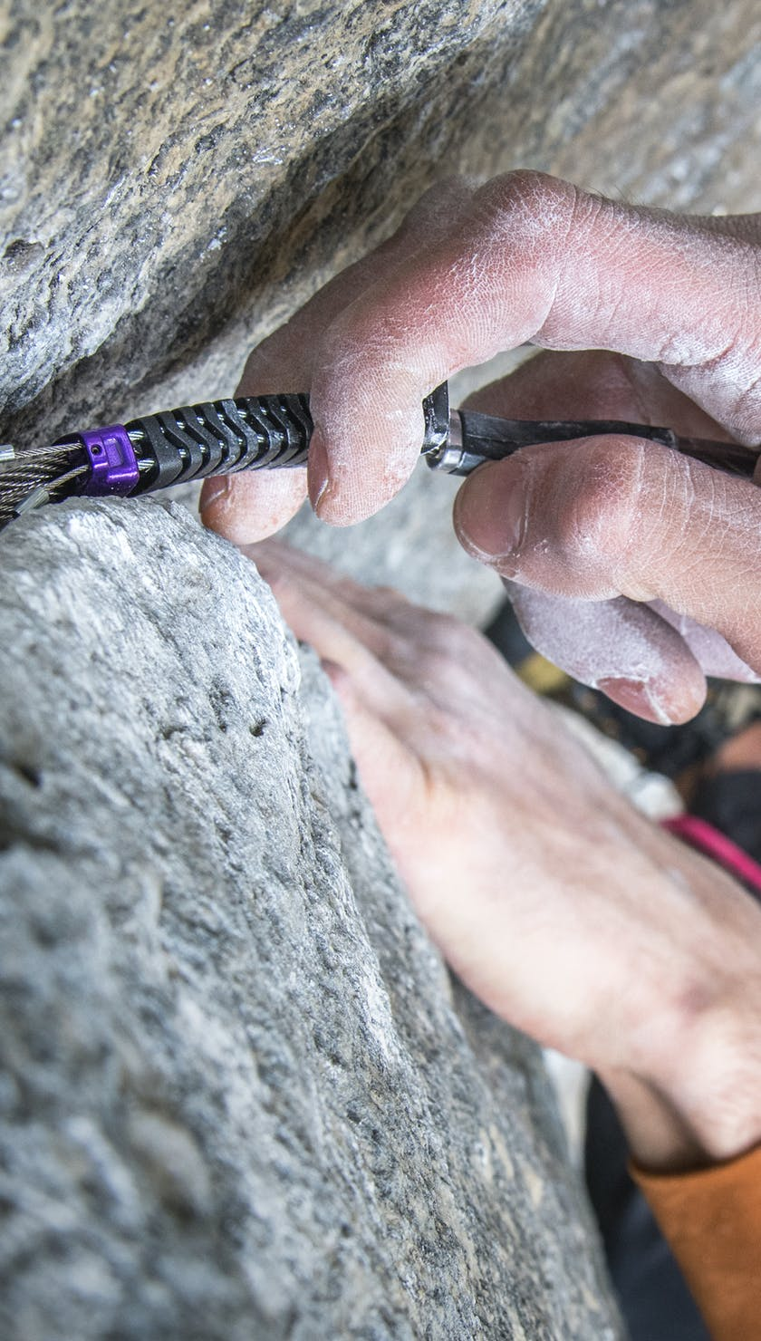 Climber placing a Z4 cam in a crack