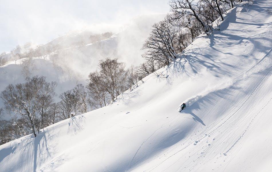 Snowboarding down Rishiri