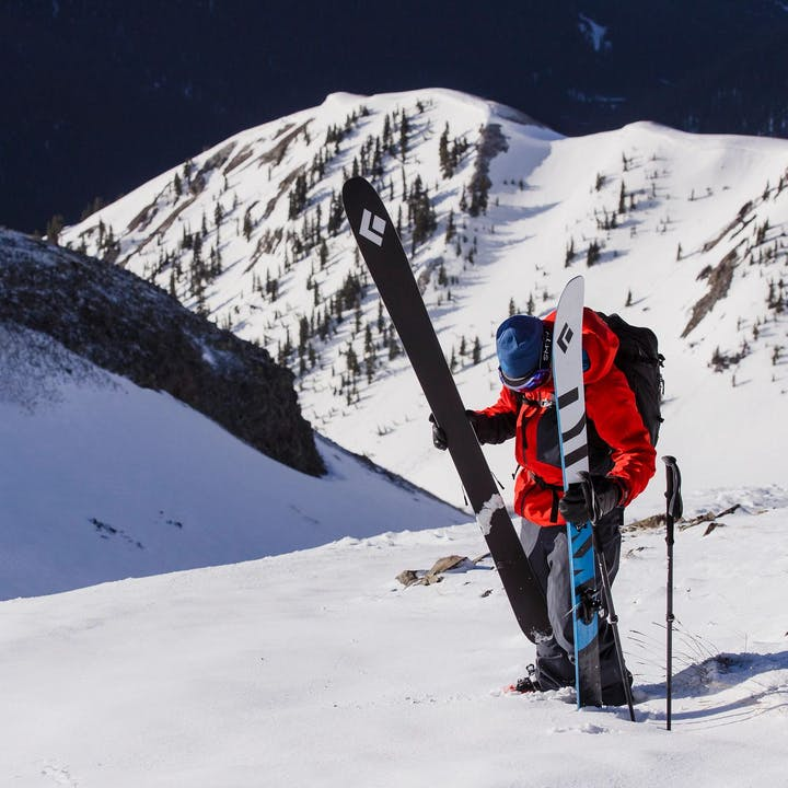 Photograph by Jeff Cricco of man prepping skis on a mountain