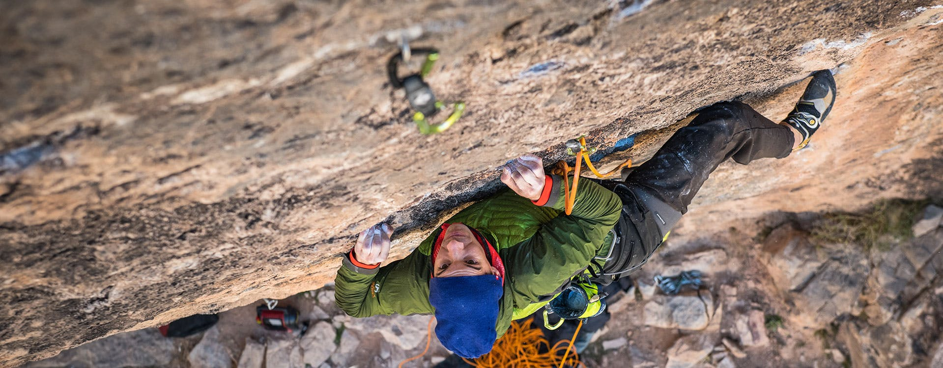 climber reaching for a hold on a route
