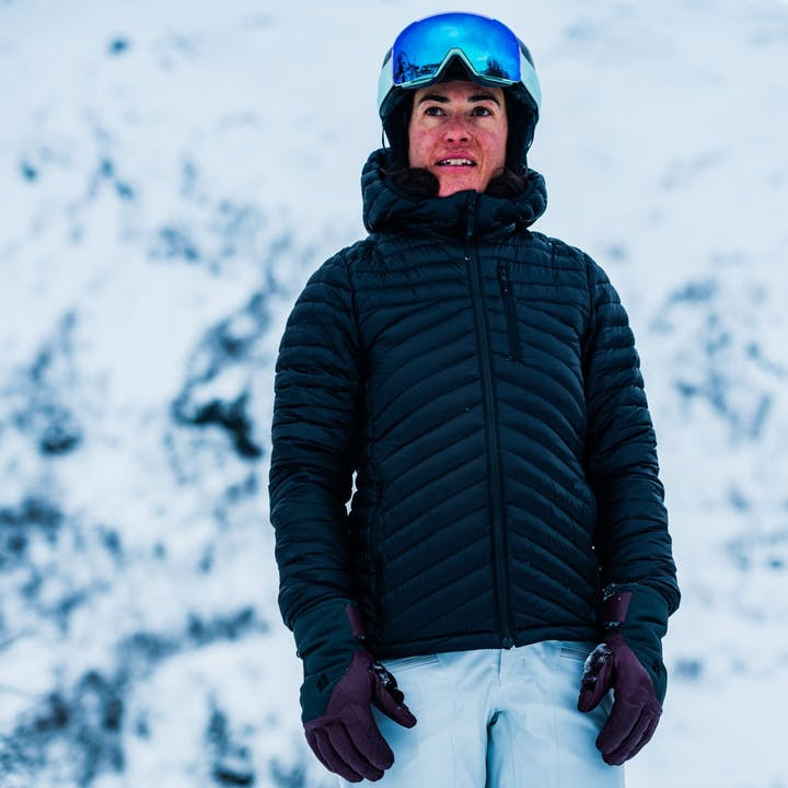 Photograph by Mattias Fredriksson of a woman in ski gear standing out in the snow