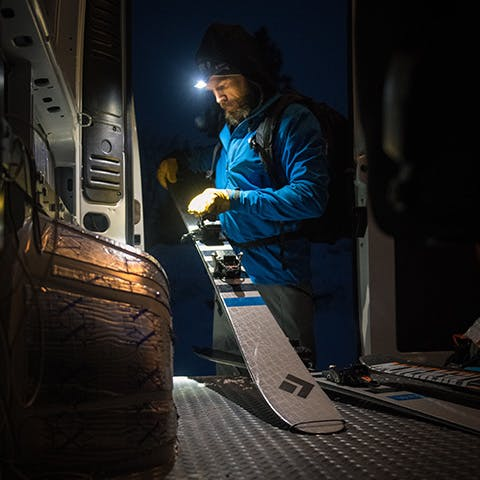 man getting his skis ready for a dawn patrol