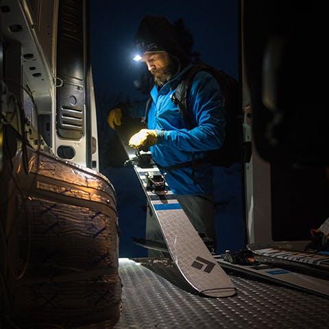 man getting his skis ready for a dawn patrol