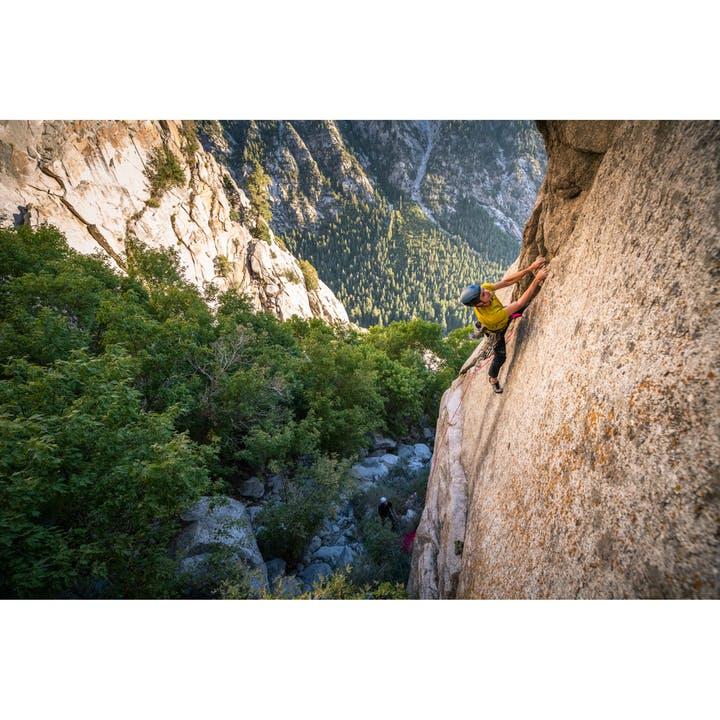 A photo by Christian Adam of a man trad climbing