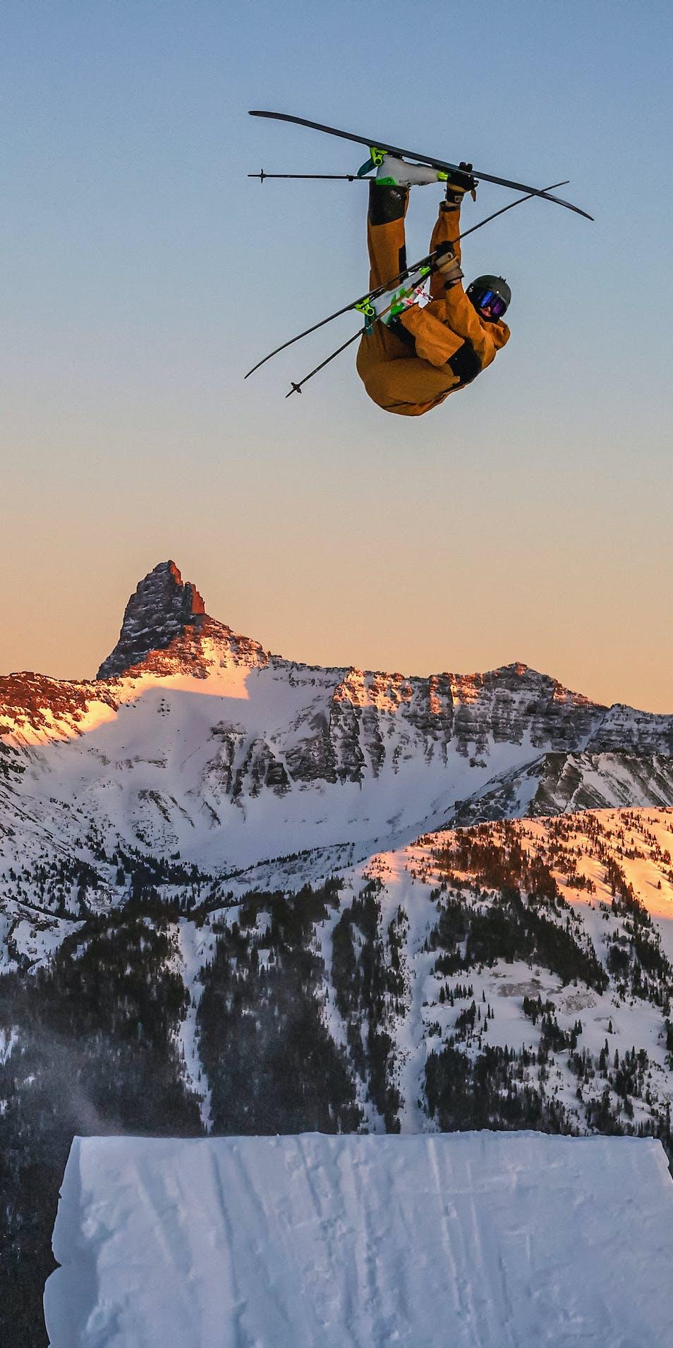 Black Diamond Athlete Parkin Costain hitting a ski jump in the backcountry