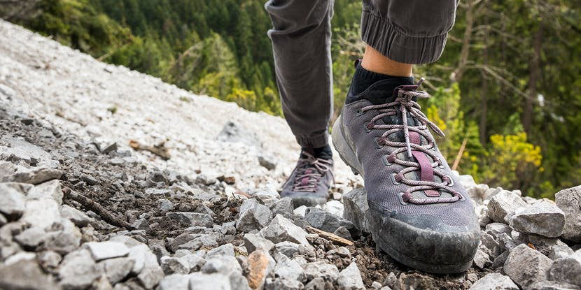 woman hiking a trail in BD Approach shoes