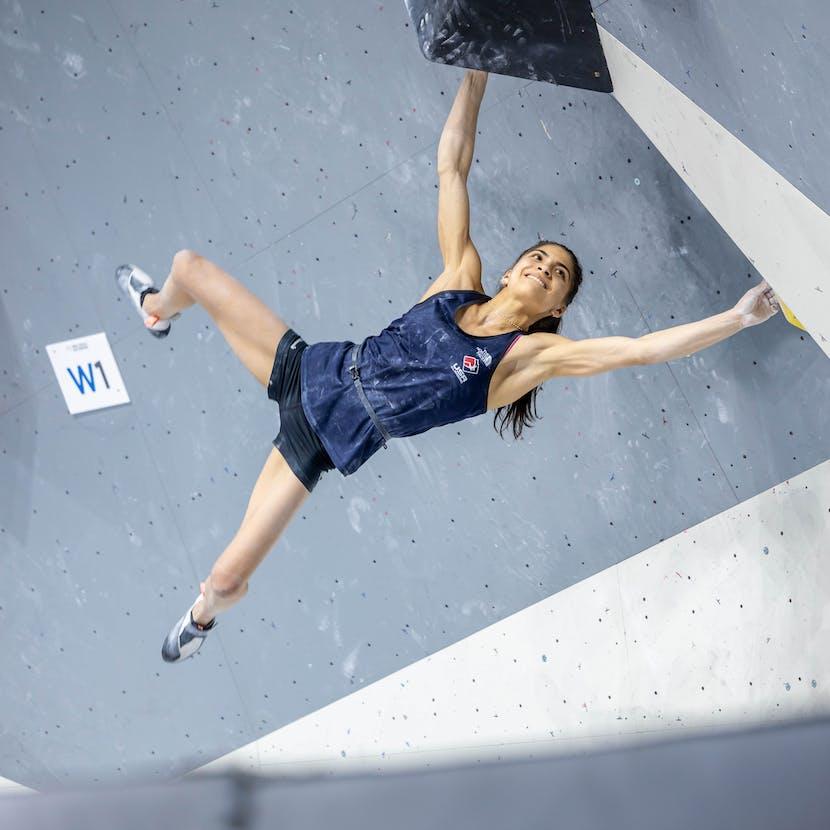 Black Diamond Athlete Natalia Grossman bouldering in a gym.