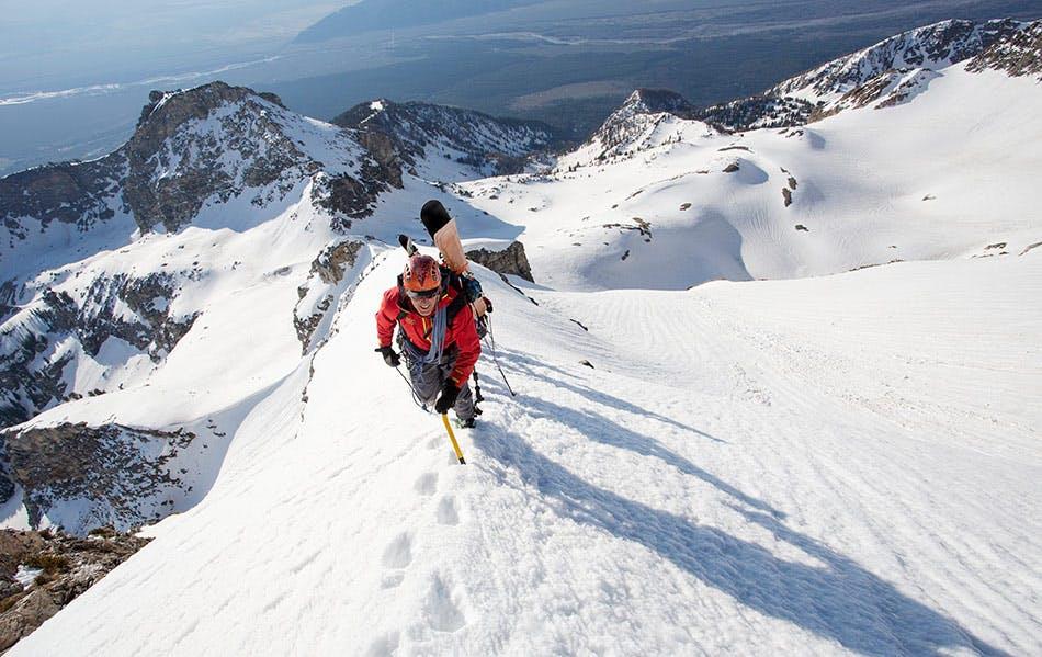 Exum guide on snowy mountain ridge