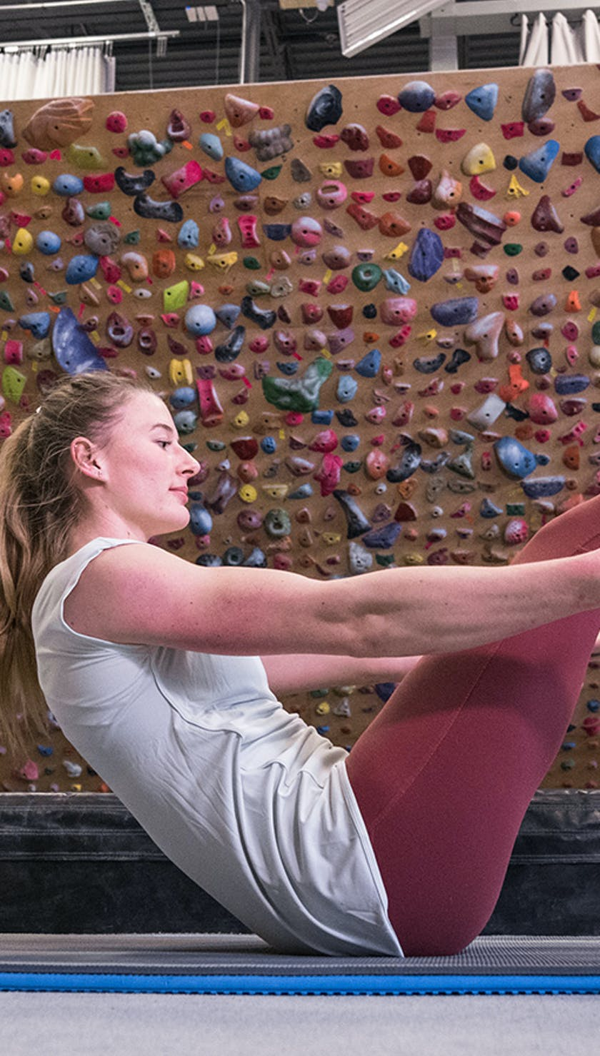 Image of Claire Buhrfeind performing core exercises in a gym.