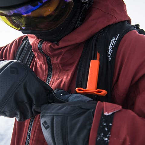 skier clipping into his Jetforce pack