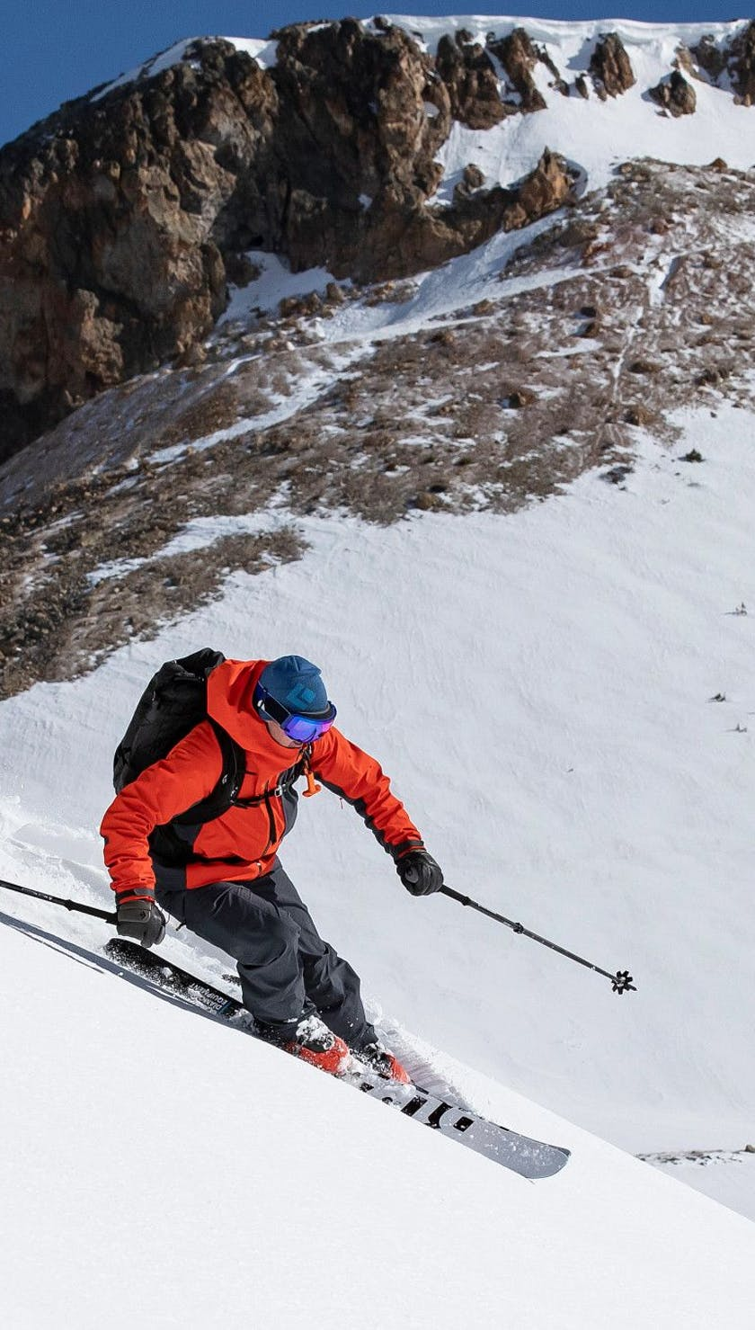 skier going into a turn on the Helio Carbon skis