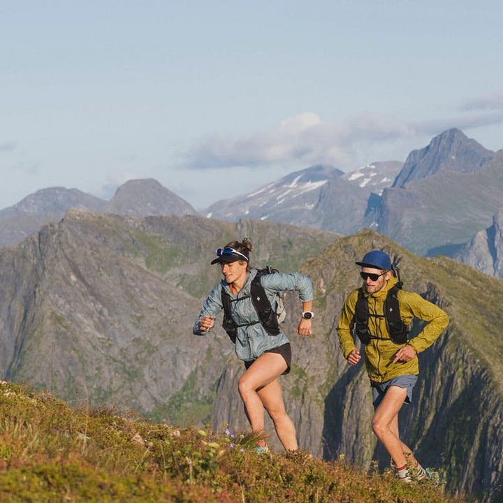 Photograph by Julen Elorza of Hillary Gerardi and Kyler Richardson running in the mountains.