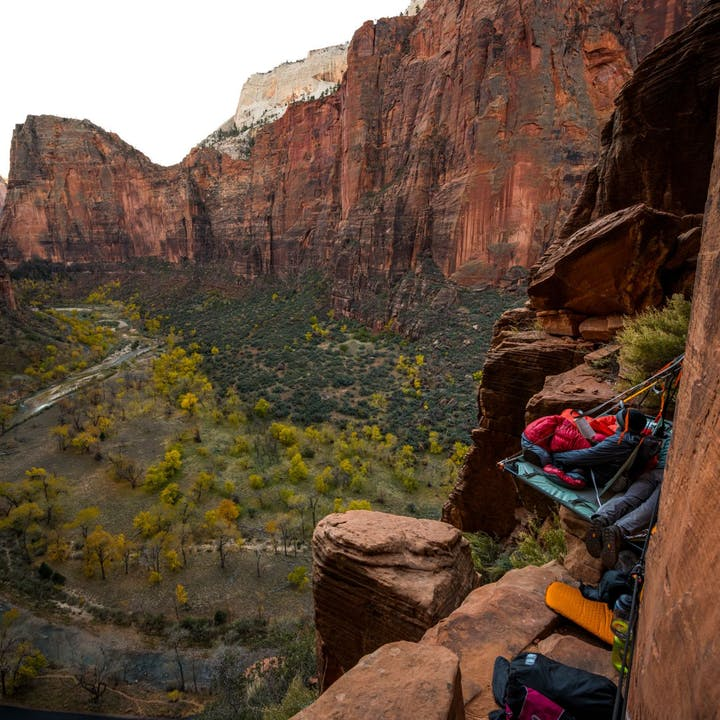 Photograph by Andy Earl of man on a portaledge overlooking Zion Valley