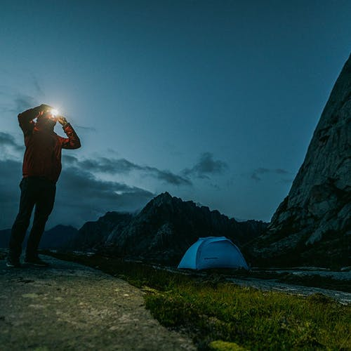 Person wearing an Icon 700 Headlamp while camping