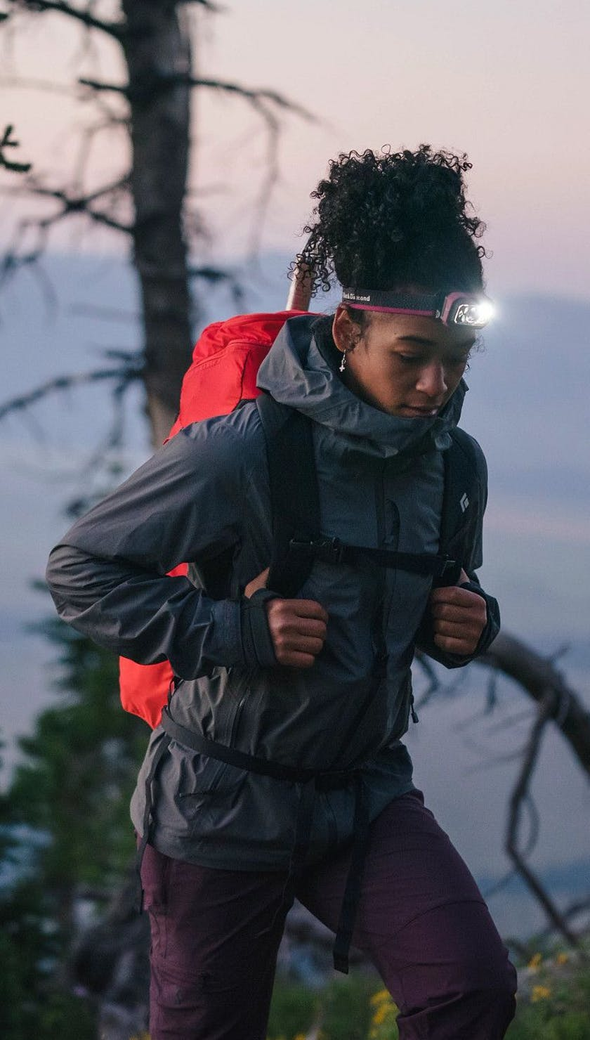 Woman out for a hike at dusk using the Storm 400 Headlamp