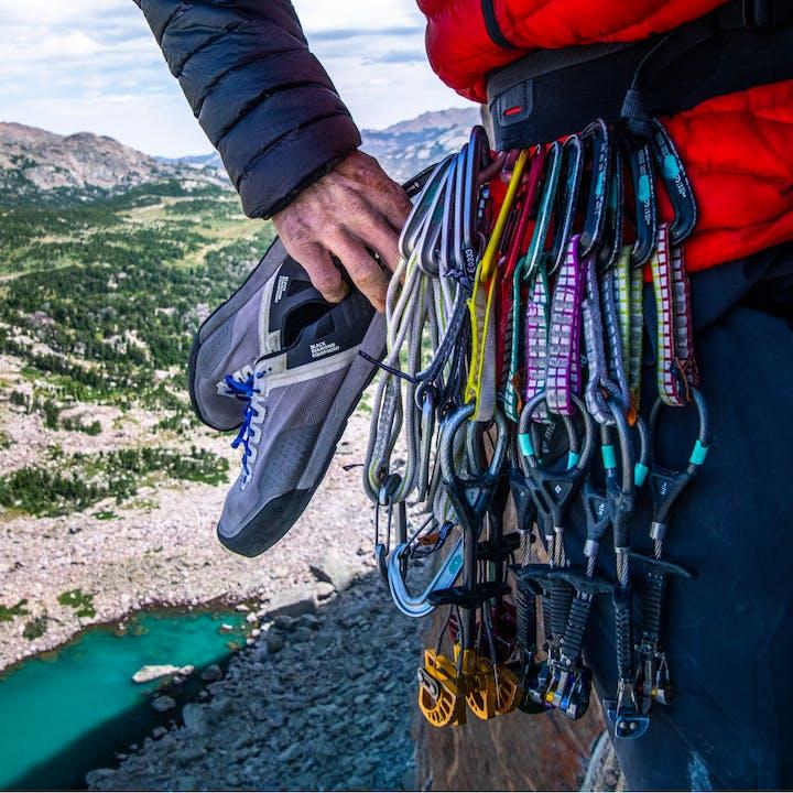 Climber using Black Diamond C4/Z4 cams while climbing.