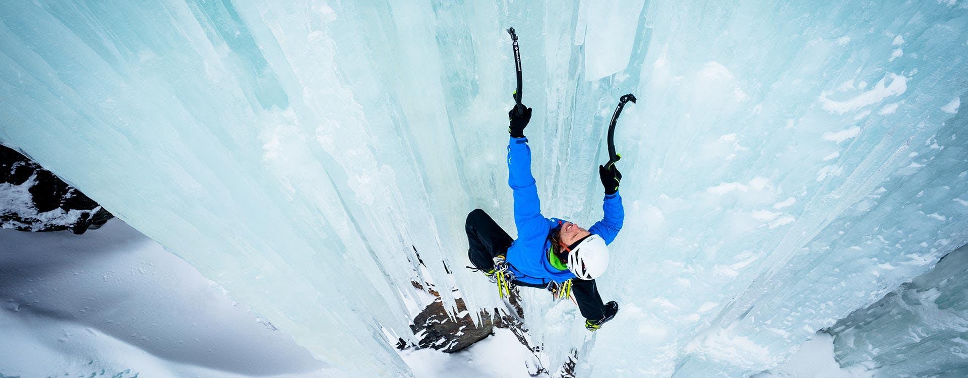 Man climbing an ice route