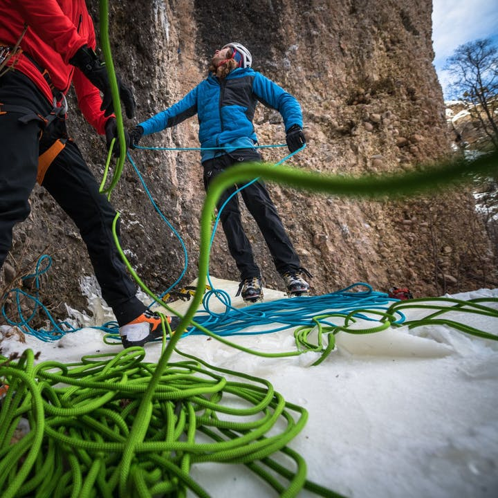Photograph by Andy Earl of Jackson Marvell preparing to ice climb
