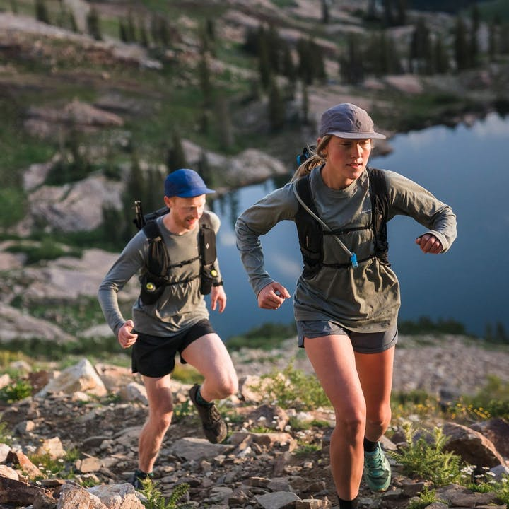 Photograph by Christian Adam of Mary McIntyre and a man trail running