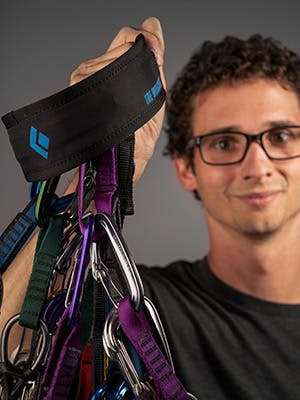 Photograph by Andy Earl of Tyler Willcutt holding his prototype gear sling.