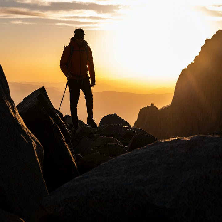 man looking out over the sunset