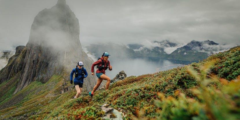 Runners along a mountain ridgeline.