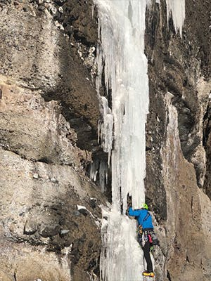 Photograph by Kolin Powick of Doug Chabot ice climbing in Montana