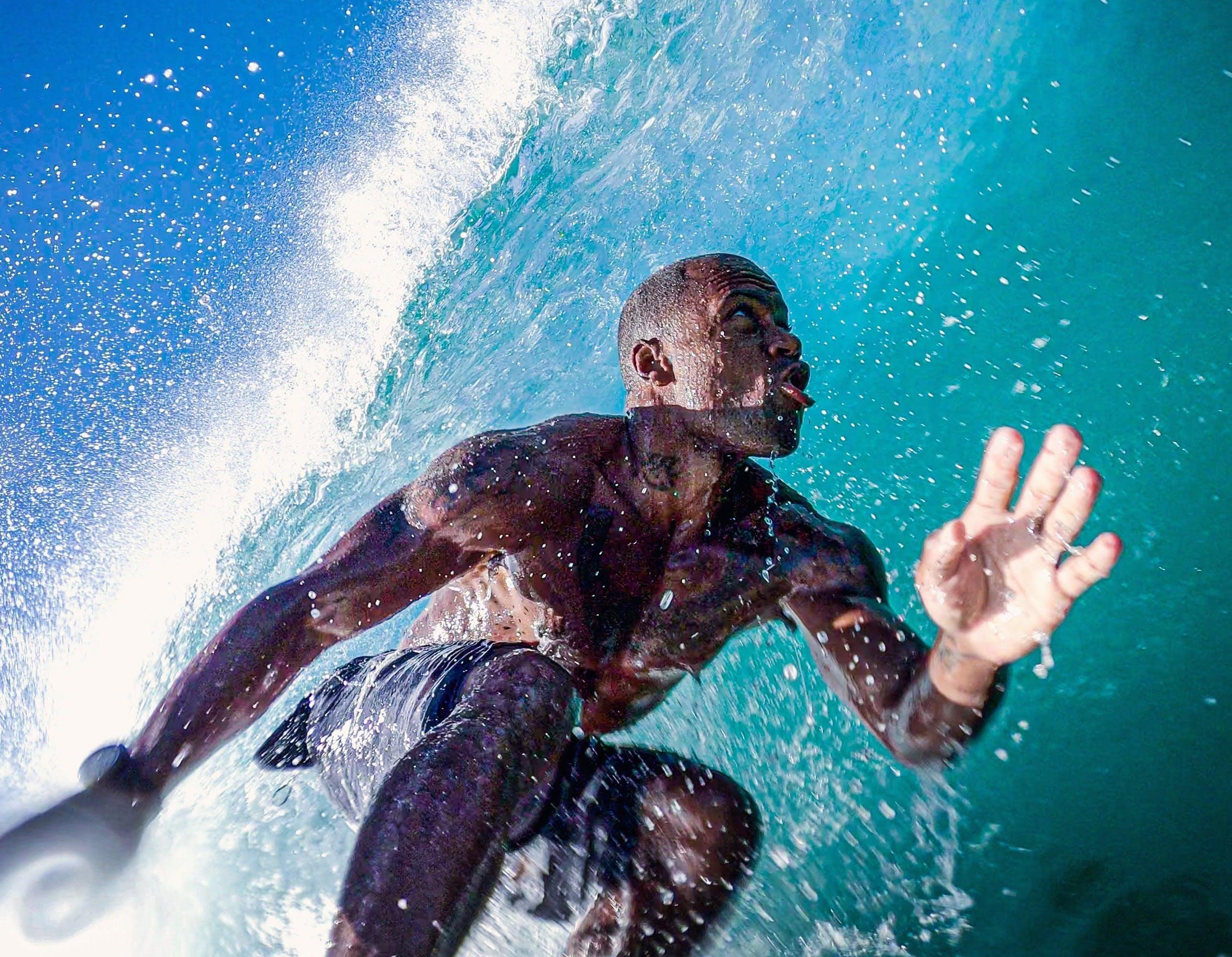 King surfs a wave