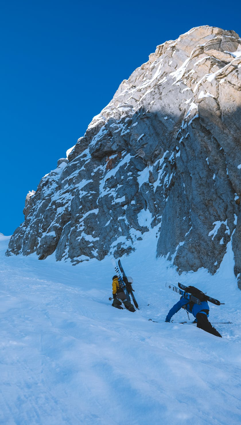 Black Diamond athlete Jérémy Prevost and a friend boot packing up couloir.